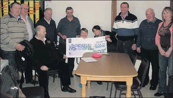 Some of the Willow Grove runners hand over the cheque to representatives of St. Catherine's Association.