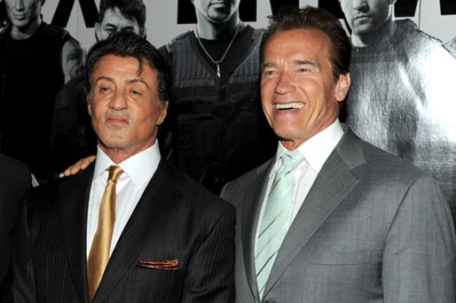 Sly and Arnie were bitter rivals in the 80s but are now close friends and dining buddies. Photo: Getty Images