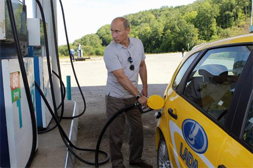 Russian Prime Minister Vladimir Putin refuels a Russian-made Lada Kalina car as he stops at a petrol station in the Khabarovsk region of Russia's far east