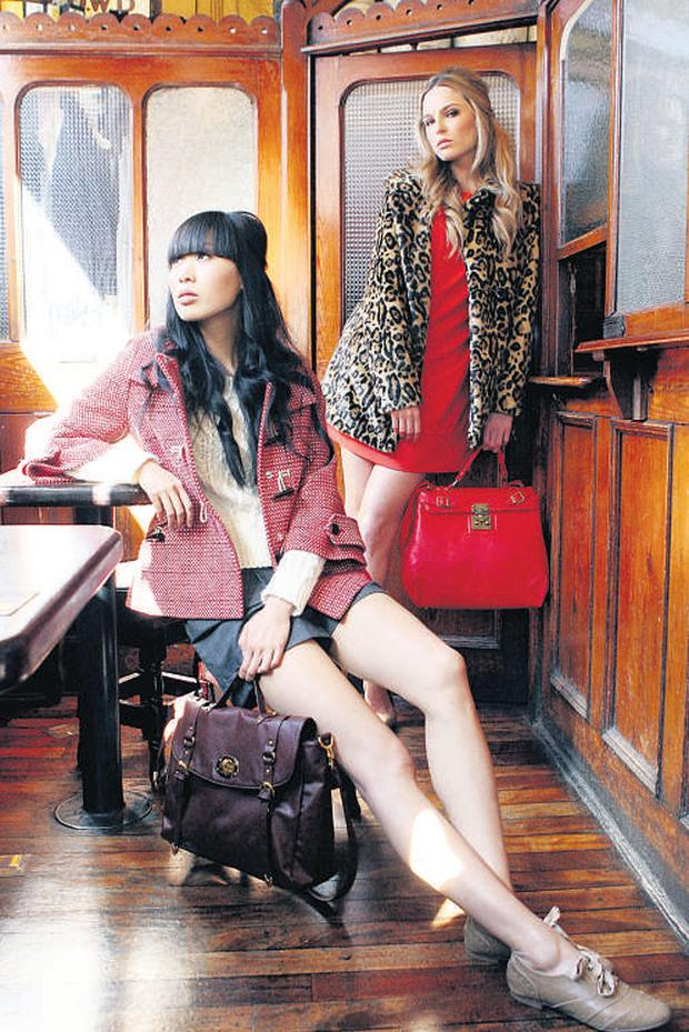 Main, Yomiko Chen and Sarah Morrissey model a selection of clothes from A-wear's new autumn collection in Dublin. Sarah wears leopard-print swing coat, €70; tamarind bow shift dress, €35 to €45; Yomiko Chen wears red woven duffle coat, €60; shorts, €30; Aran knit jumper, €35. Inset, lace shift dress, €40; coral bow coat, €50; peak cap, €15. JAMES HORAN/COLLINS PHOTOS