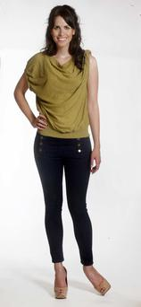 Olive green top, €24.95, H and M; navy jeans, €25.95, Zara; patent nude shoes, €69.95, Zara