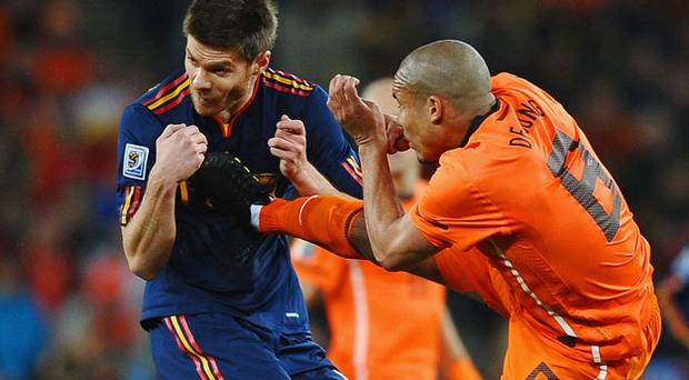 Nigel de Jong (right), the Holland midfielder, thrusts his boot into Xabi Alonso's chest in the 2010 World Cup final. Photo: Getty Images
