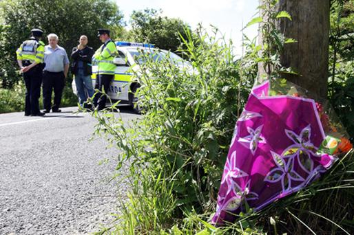 Flowers at the scene of the crash. Photo: PA