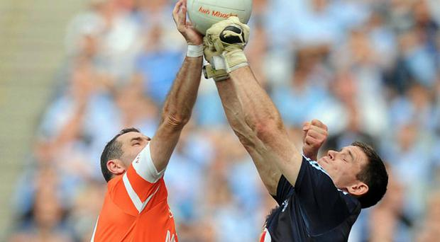 Armagh's Steven McDonnell scores a point under pressure from Dublin goalkeeper at Croke Park on Saturday. Photo: David Maher / Sportsfile
