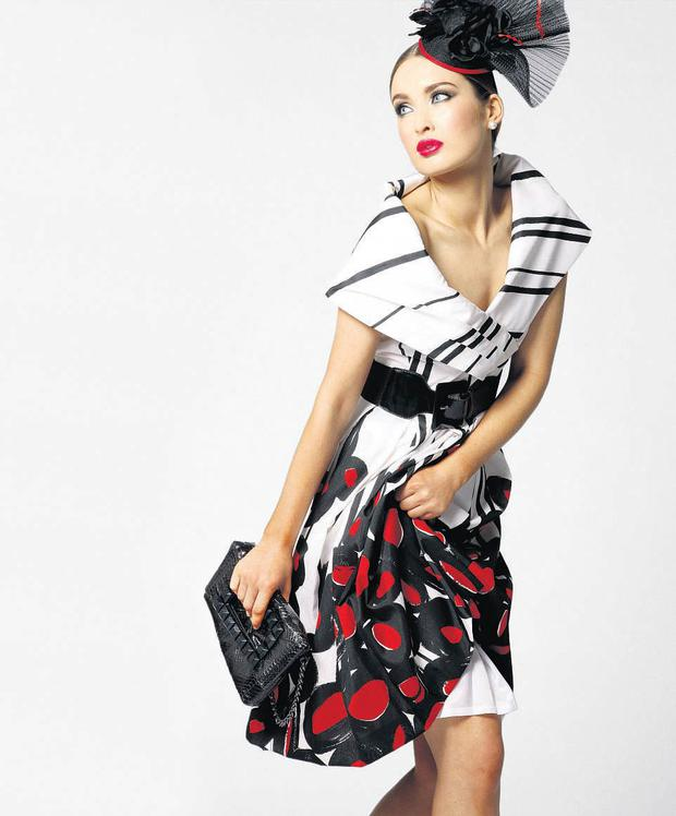 Michel Ambers dress, €173.95, and matching white, black and red headpiece, €74.95