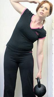 Dedicated: Yvonne practises one of the hotel-workout exercises.