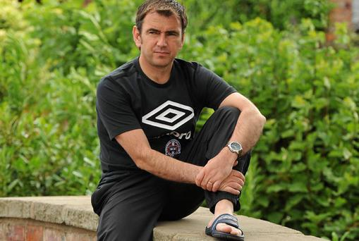 Pat Fenlon relaxes yesterday before taking charge of Boh's training session.