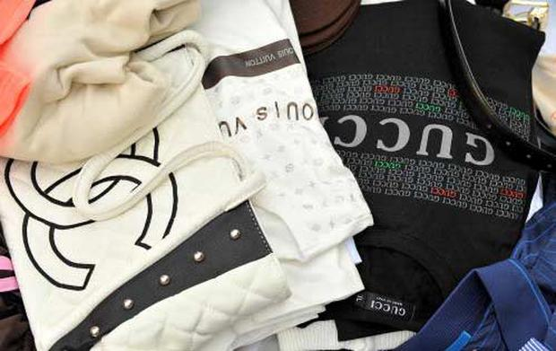 A selection of fake designer goods recently seized by French police. Photo: AFP/Getty