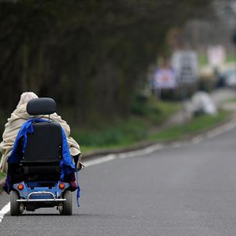 A pensioner had to be rescued after ending up on a busy A-road on a mobility scooter