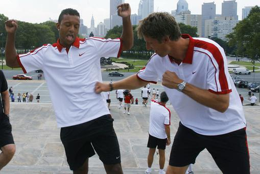 Nani dodges a 'punch' from Manchester United team-mate Edwin Van Der Sar on the steps made famous in the movie 'Rocky' at the Philadelphia Art Museum in Philadelphia, Pennsylvania, yesterday. Photo: Reuters