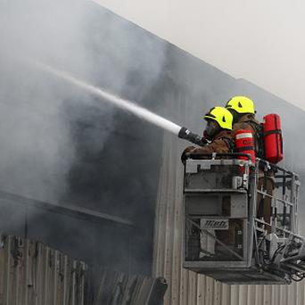 A sacked fireman has been awarded compensation in a row over uncomfortable chairs