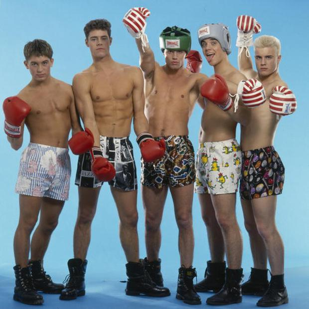 English boy band Take That pose in combat boots, boxer shorts and red boxing gloves, as worn in their first video 'Do What You Like', 1991. From left to right, Mark Owen, Howard Donald, Jason Orange, Robbie Williams and Gary Barlow. (Photo by Dave Hogan/Hulton Archive/Getty Images)