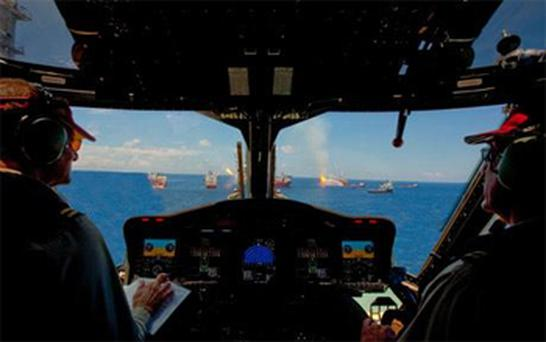 The photo's caption on the BP site reads: 'View of the MC 252 site from the cockpit of a PHI S-92 helicopter 26 June 2010.' Photo: BP