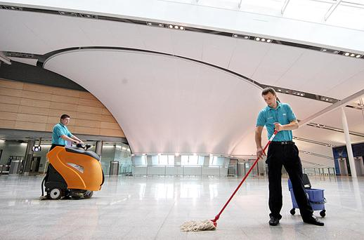Cleaners at work on the floors of the new Terminal 2. All photos: Frank McGrath