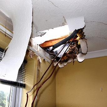 Damage caused to Vince Foote's flat in Chichester after a huge block of ice crashed through his roof as he and his wife slept