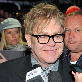 A bout of food poisoning has caused the postponement of a concert by Sir Elton John in Arizona