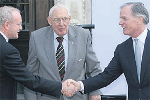 Accused: Martin McGuinness and Ian Paisley greet Tom Foley, the former US ambassador to Ireland, in 2008