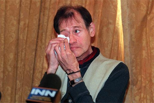 Higgins gets upset at a press conference at which he announced plans to sue a tobacco company