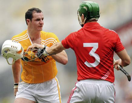 Antrim's Liam Watson, grapples with Cork's Eoin Cadogan before being sent off. Photo: Oliver McVeigh / Sportsfile
