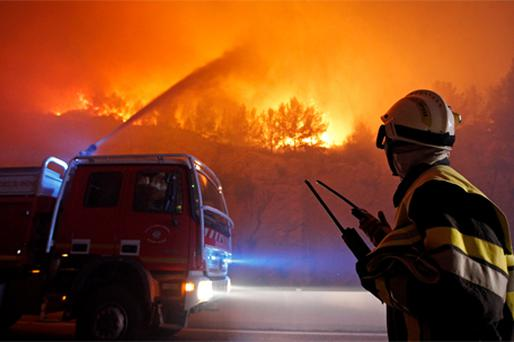 Fire crews tackle the flames in a pine forest in Sausset-les-Pins, near Marseille in southern France, yesterday