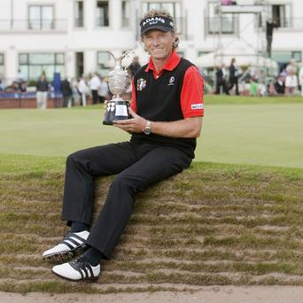 Germany's Bernhard Langer holds the Claret Jug after winning British Senior Open at Carnoustie Golf Club yesterday. Photo: PA