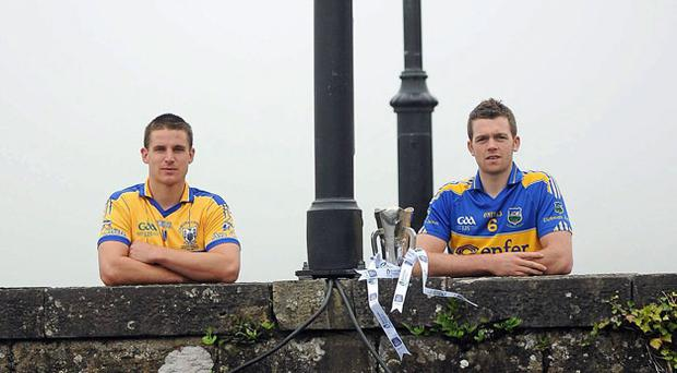 Tipperary captain Padraic Maher (right) and Clare captain John Conlon met halfway on the bridge at Killaloe, Co Clare and Ballina, Co Tipperary, ahead of tomorrow night's Bord Gáis Energy Munster GAA U-21 hurling final.