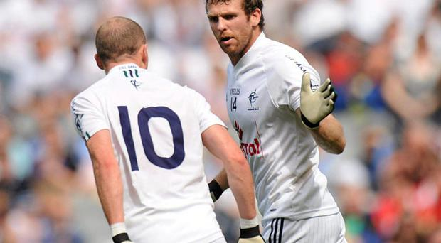 Ronan Sweeney celebrates after scoring Kildare's goal against Monaghan with James Kavanagh.