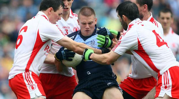 Dublin's Tomas Quinn is crowded out by Conor Gormley, Justin McMahon, Ryan McMenamin, and Ciaran Gourley during the last Championship meeting. between the teams in 2008