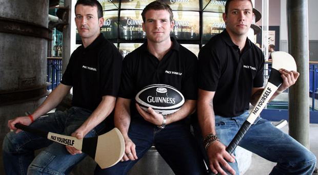 Hurlers Donal Og Cusack (L) and Dan Shanahan (R) and Leinster and Ireland rugby player Gordon D'Arcy launch the Guinness 'Pace Yourself' campaign at the Guinness Storehouse yesterday. Photo: INPHO / DAN SHERIDAN