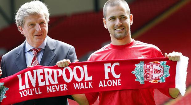 Liverpool's new signing Joe Cole and manager Roy Hodgson (left) during the unveiling at Anfield yesterday. Photo: PA
