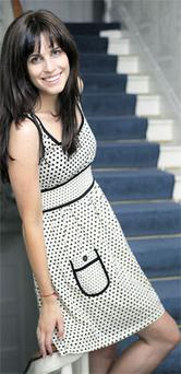 HOLLY WEARS: Cream and black polka-dot dress, €49.90, Mango