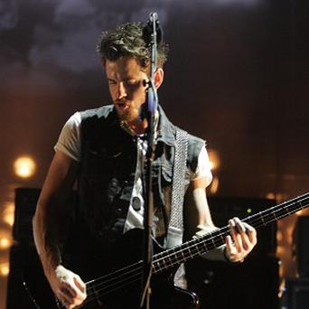 Kings of Leon star Jared Followill was targeted by a flock of pigeons, forcing the cancellation of a US concert