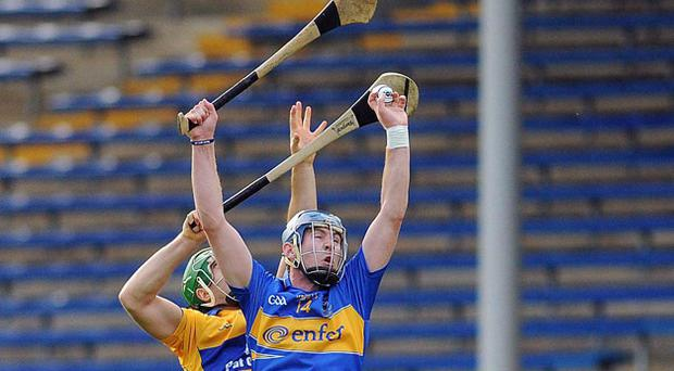 Tipperary's Paddy Murphy wins this aerial battle with Clare's Cathal Chaplin in last night's Bord Gais Munster U21 hurling final.