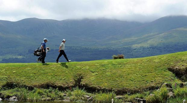Rory McIlroy makes his way to the fourth tee box with his caddy JP Fitzgerald during yesterday's Pro-Am in Killarney. Photo: Matt Browne / Sportsfile