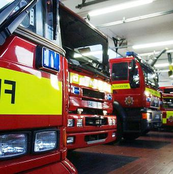 Firefighters were called in to help a pensioner who smashed his car through a garden and a brick wall, then into a house