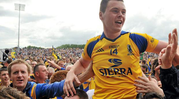 Donie Shine is held aloft after Roscommon's Connacht SFC final victory. Photo: Brian Lawless / Sportsfile