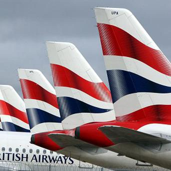 British Airways said the ash cloud crisis and strikes by cabin crew had an impact