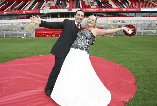 Sue Collins and Barry Hogan on the pitch at Thomond Park where they became the first couple to get married in the famous stadium. Photo: Emma Jervis
