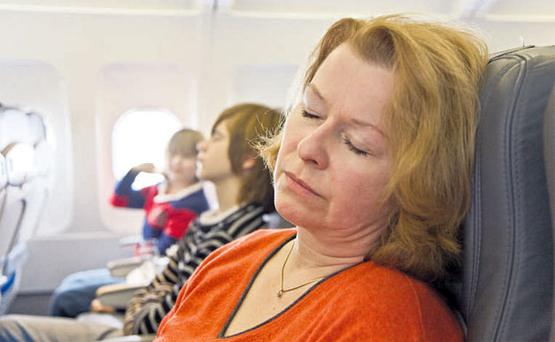 Keep moving: Don't let yourself sleep upright for the entire duration of a long-haul flight.