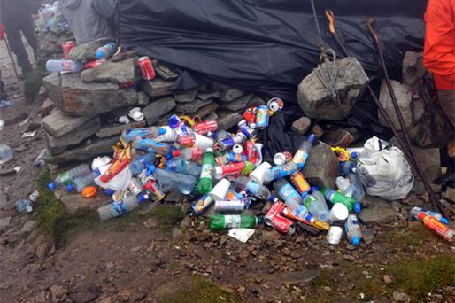 BIG CLEAN-UP: Litter on the ground beside a kiosk at the top of Croagh Patrick after the Reek Sunday climb