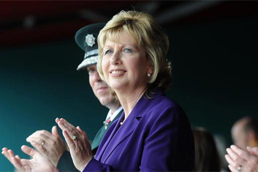 ALLIES: Mary McAleese and, background, PSNI Chief Matt Baggott at the PSNI graduation ceremony