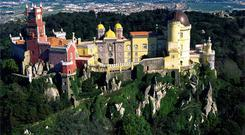 BRIGHT AND BEAUTIFUL: Pena National Palace sits high up in the mountains of Sintra, a Unesco world heritage site