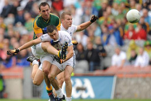 Meath's Graham Reilly in action against Kildare duo Aindriu MacLochlain and Peter Kelly during yesterday's All-Ireland SFC quarter-final win