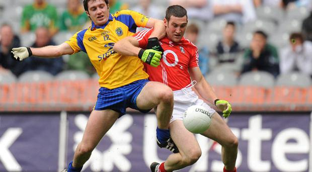 Roscommon's Cathal Cregg tussles with Noel O'Leary of Cork during yesterday's All-Ireland SFC quarter-final in Croke Park. Photo: Oliver McVeigh / Sportsfile