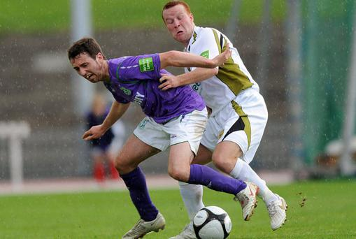 Paddy Kavanagh (left) and Lorcan Fitzgerald battle it out at Morton Stadium.