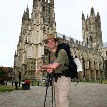 James Milton, a former Army captain after completing a 130-mile barefoot charity walk from Winchester cathedral to Canterbury cathedral