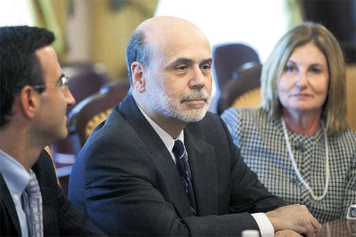 Fed chairman Ben Bernanke at a meeting in the US Treasury in Washington at the weekend where scrapping tax cuts by year end for wealthy Americans was discussed