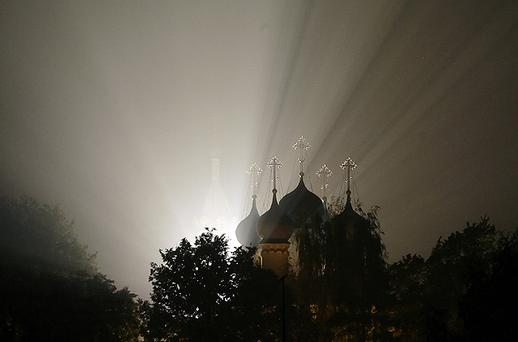 Light shines through forest fire smoke near a Russian Orthodox church 30km from Moscow in Zelenaya Sloboda