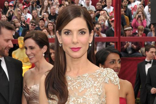 Sandra Bullock was named by Forbes.com as the biggest female earner in Hollywood in the past 12 months, beating Cameron Diaz and Reese Witherspoon