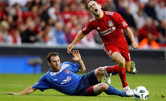 Joe Cole feels the pain as he is fouled by Rabotnicki Skopje's Goce Todorovski during their Europa League match at Anfield last night